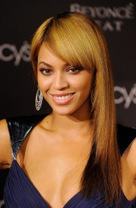 Trying her hand at bangs, Beyonce opted for straight' sliced layers.